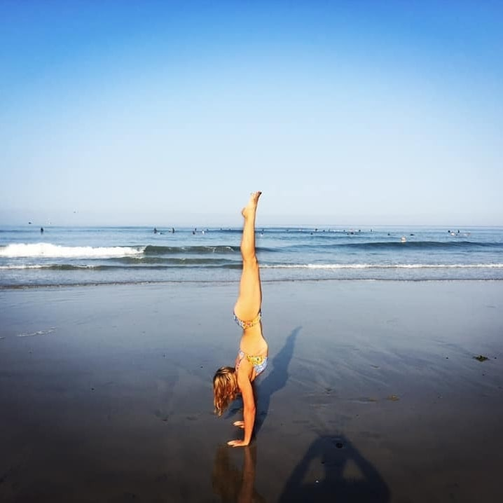 Hand-stand-on-beach